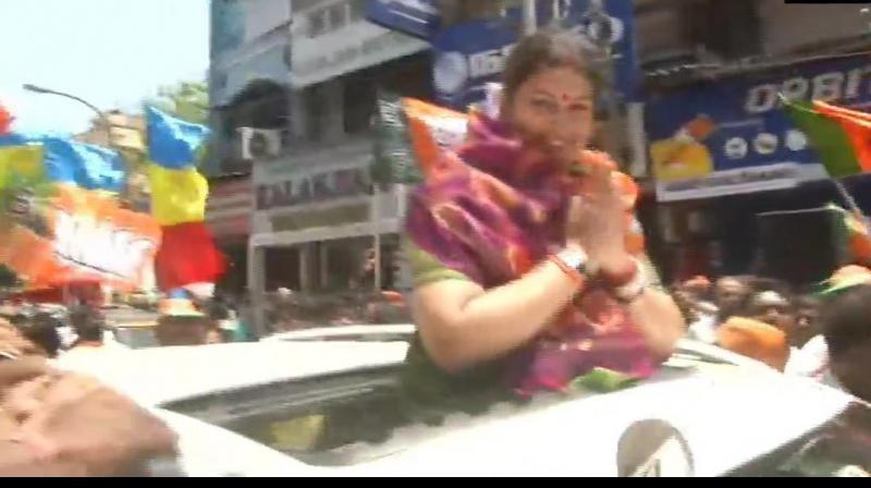 Union Minister Smriti Irani holds a roadshow in Tamil Nadu on Sunday. (Photo: Twitter/ ANI)
