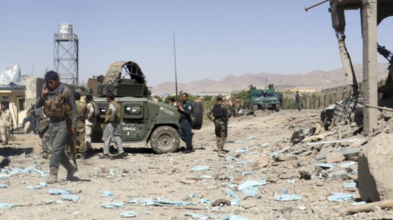 Security forces are deployed at the site of suicide attacks and an ongoing clash between Taliban insurgents and government forces in the main police station in eastern Paktia province, Afghanistan. (Photo: AP)