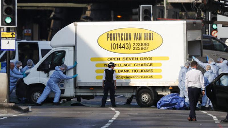 b53d5bd8d5945c Forensic officers move the van at Finsbury Park in north London