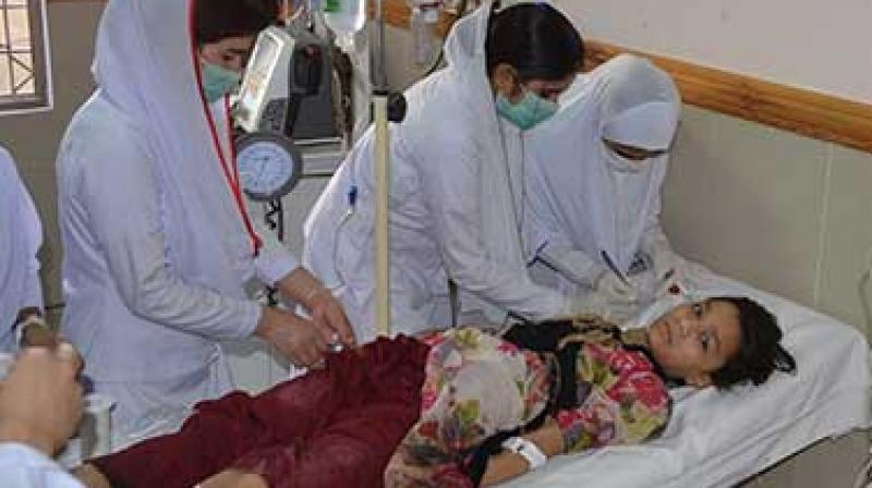 Pakistani nursing staff attend an injured girl at a hospital in Quetta, Pakistan. A powerful bomb went off near the office of the provincial police chief in southwest Pakistan on Friday, causing casualties, police said.