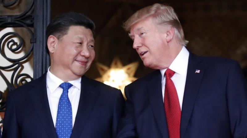 Xi Jinping with Donald Trump. (Photo: AP)