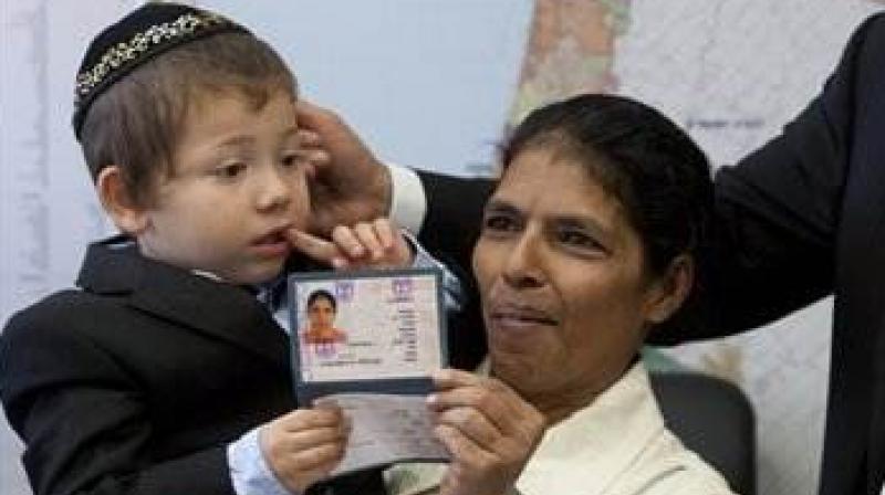 Baby Moshe with his Indian nanny Sandra Samuels. (Photo: AP)