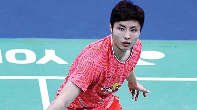 China's Shi Yuqi in action against Iskandar Zulkarnain of Malaysia in their India Open semi-final on Saturday. (Photo: AFP)