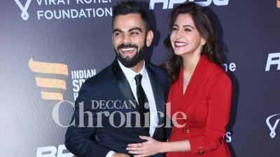 "The ""it couple"" of Virat Kohli – Team India skipper – and Anushka Sharma – Bollywood actress – walked in together and posed for the cameras ahead of the Indian Sports Honours in Mumbai on Saturday. (Photo: Deccan Chronicle)"