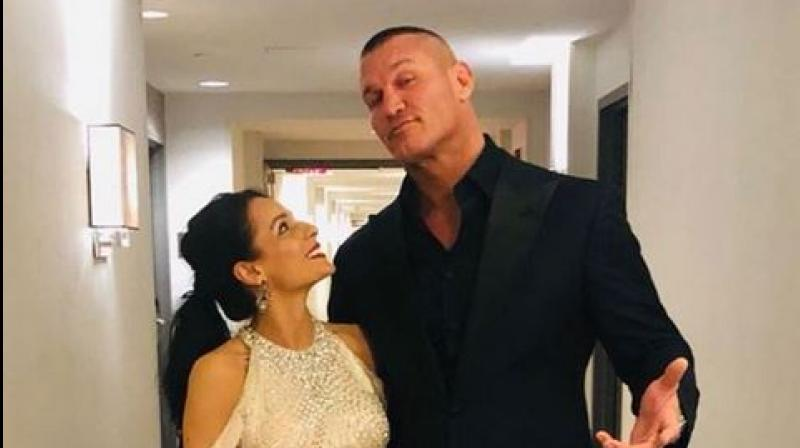 Yesterday he shared a video on Instagram that shows him receiving an RKO from his wife straight into a pool. (Photo: Instagram/randyorton)