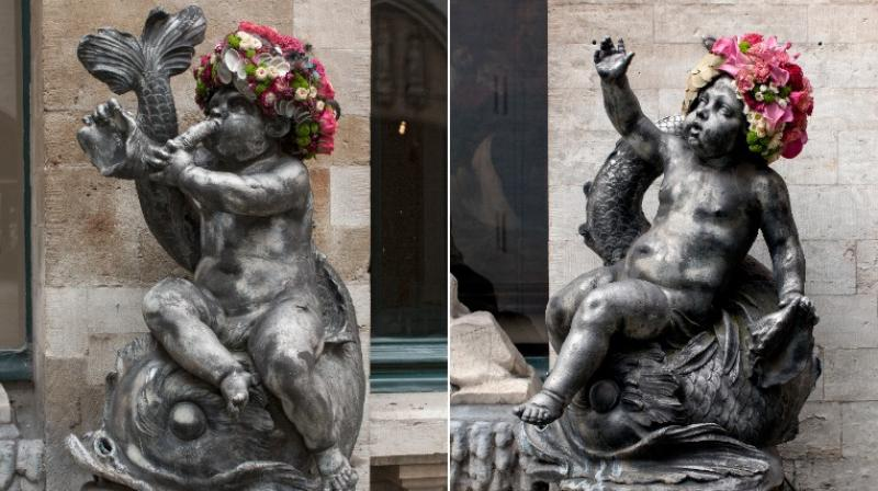 Cherubs in Brussels adorned with colourful floral headdresses for Flowertime, an international flower arranging event.(All Images provided by Geoffroy Mottart)