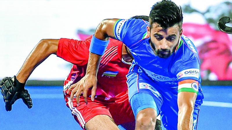 Indian captain Manpreet Singh in action against Uzbekistan during  a match in the FIH Men's Series Finals at Kalinga Stadium in Bhubaneswar. (Photo: PTI)