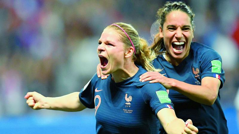 France's forward Eugenie Le Sommer (left) celebrates after scoring a goal during the Women's World Cup Group 'A' football match against Norway at the Nice Stadium in Nice on Thursday. (Photo: AFP)