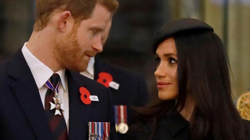 Britain's Prince Harry (L) and his US fiancee Meghan Markle attend a service of commemoration and thanksgiving to mark Anzac Day in Westminster Abbey in London on April 25, 2018. (Photo: AFP)