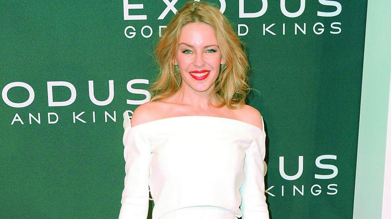 Kylie Minogue line dances her way through Dancing music video