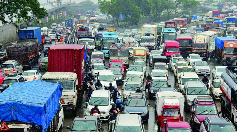Vehicles stuck in a traffic congestion on Sion-Panvel highway due to rains, in Mumbai on Thursday.  (PTI)