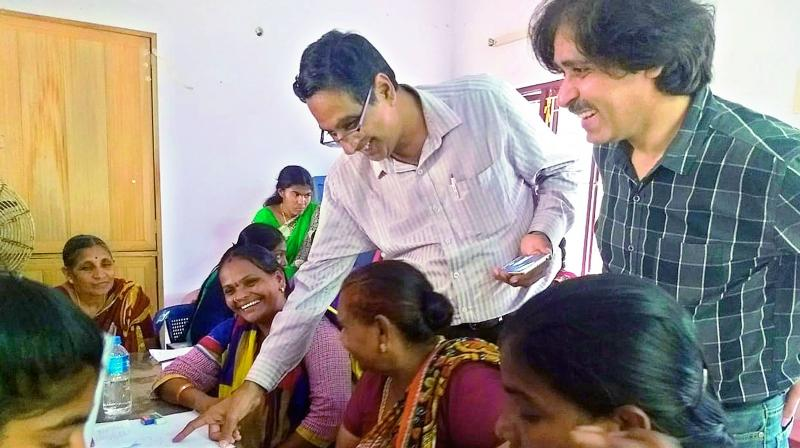 Sharad Sharma of World Comics India gives tips to young women and adolescent girls at CM's Urban Health Centre in Vijayawada on Saturday.