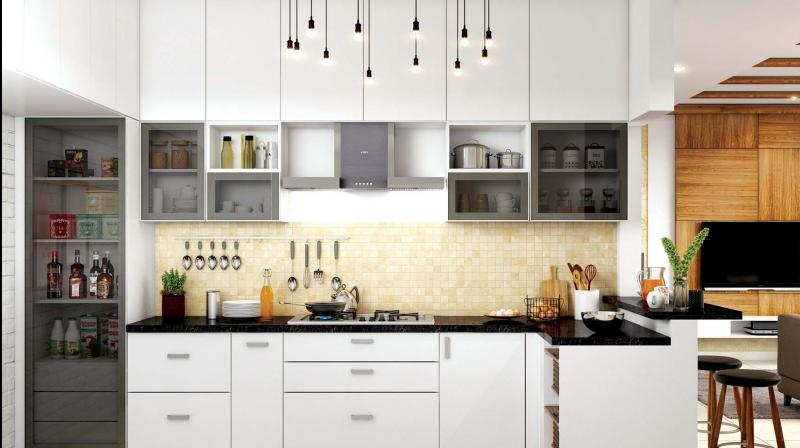A kitchen with ornamental lighting.