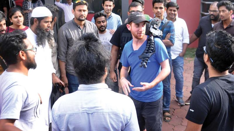 Drew interacts with his followers in Kochi.