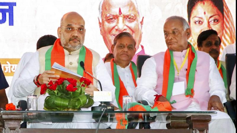 Bharatiya Janata Party President Amit Shah with party's Rajasthan President Madan Lal Saini at the party's 'Shakti Kendra Sammelan', in Jaipur. (Photo: PTI)