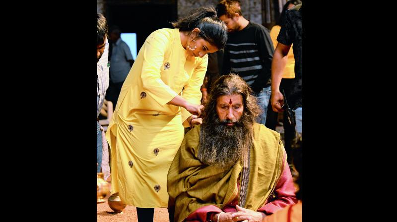 On the sets: Sushmita gives the final touches to Amitabh Bachchan.