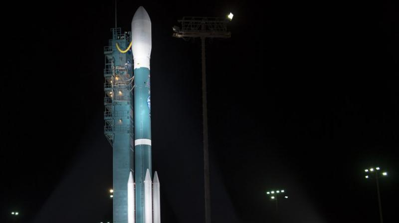 The United Launch Alliance (ULA) Delta II rocket with the NASA Ice, Cloud and land Elevation Satellite-2 (ICESat-2) onboard is seen shortly after the mobile service tower at SLC-2 was rolled back at Vandenberg Air Force Base, Calif. The ICESat-2 mission will measure the changing height of Earth's ice. (Bill Ingalls/NASA via AP)