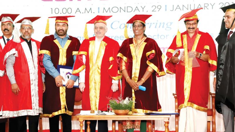 Mohanlal and P.T. Usha with Governor P. Sathasivam at Calicut university  convocation ceremony on Monday. Education Minister C. Raveendranath is also seen.