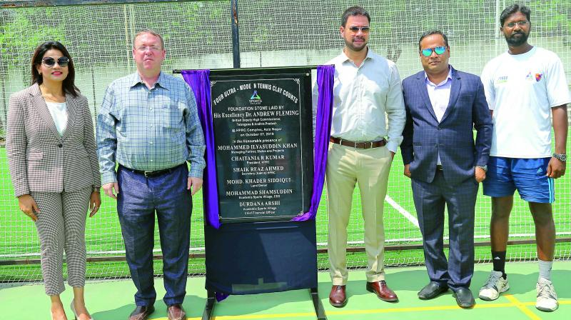 British Deputy High Commissioner Dr Andrew Fleming (second from left) poses with Academia Sports Village COO Durdana Arshi (left), CEO Mohammad Shamsuddin (right) and Mohammed Ilyasuddin Khan (second from right) after unveiling the foundation stone for four tennis clay courts of international standard at the HPRC Complex in Aziz Nagar.