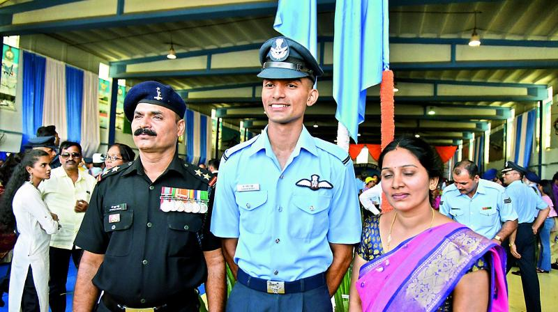 Flying Officer Gajulapalli Navin Kumar Reddy with his father Pulla Reddy and mother Soujanya