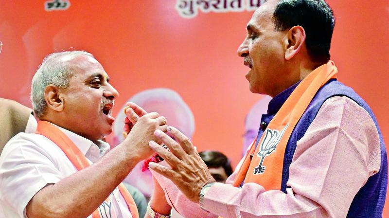Rupani sworn in as CM of Gujarat second time