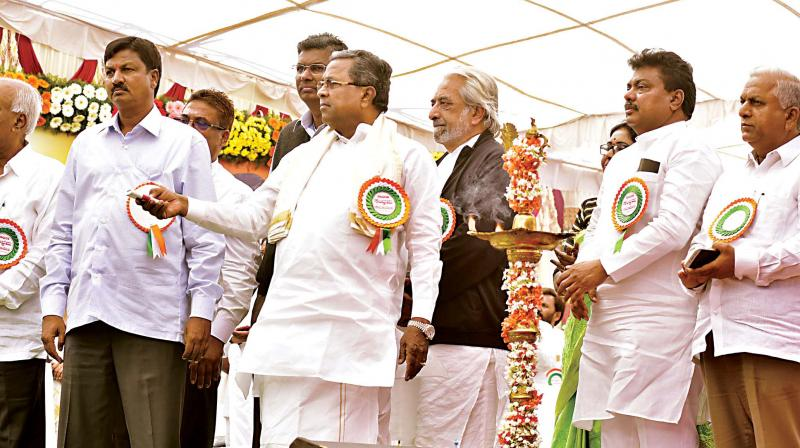 Chief Minister Siddaramaiah launches development projects in Belagavi district on Friday. (Photo: KPN)