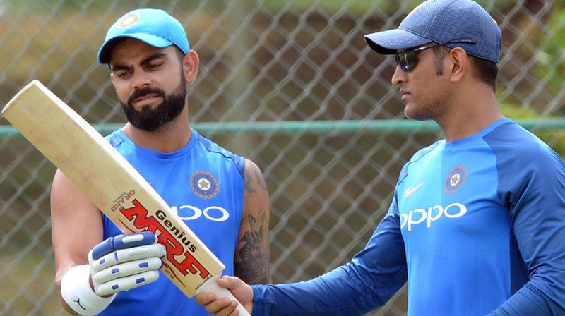 When an astute brain meets a superlative performer, there is bound to be lot of mutual admiration and the Kohli-Dhoni relationship is no different. (Photo: AFP / File)