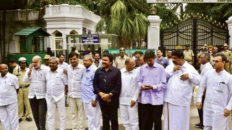 A file photo of the  disqualified MLAs at Raj  Bhavan in Bengaluru