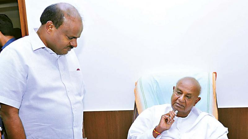 JD(S) leaders H.D. Deve Gowda and H.D. Kumaraswamy seen in discussion at JP Bhavan in Bengaluru on Wednesday. (Photo: KPN)