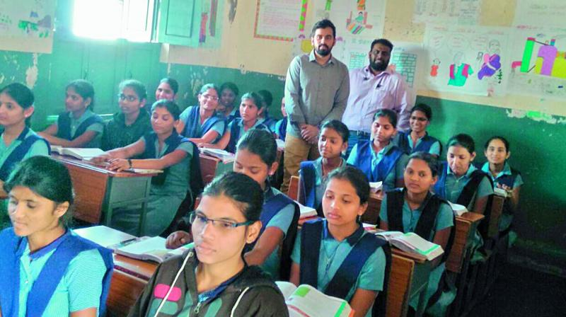 Members of Startup Egnify interact with students at a government school as part of their pilot project.