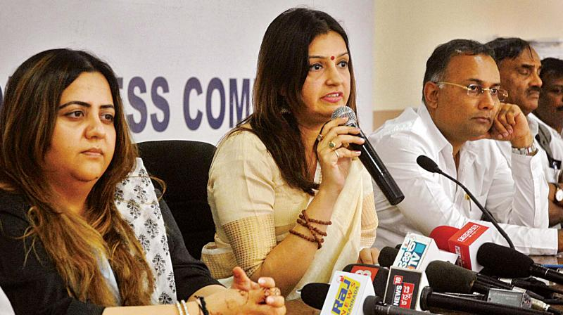 AICC national convenor Priyanka Chaturvedi, Radhika Kera and Dinesh Gundurao at a press meet on Thursday. (Photo: DC)