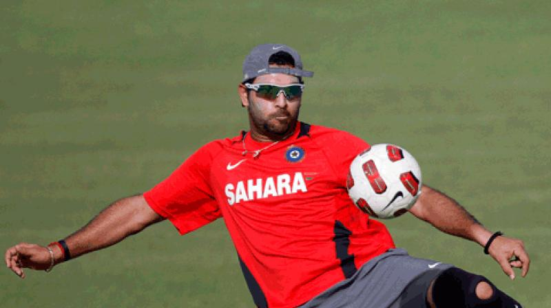 The Indian team also plays football as a part of its warm-up and the witty Yuvraj provided his expert comments on his teammates' football skills. (Photo: AP)