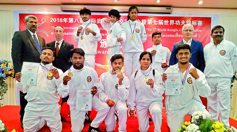 Kung fu practitioners from across the country among which five are from Telangana pose with their medals.