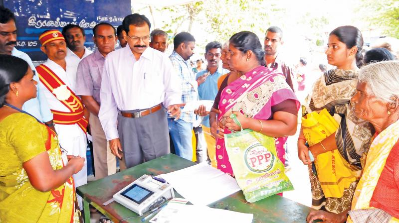 Collector K.S. Palanisamy inspecting the on-going distribution of Pongal gifts at a ration shop in Tirupur on Tuesday. (Image DC)