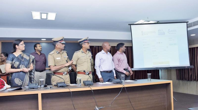 City police commissioner A. K. Vishwanathan along with the ADGP, state crime records bureau Seema Agarwal  launch online police verification services on Wednesday. (Image DC)
