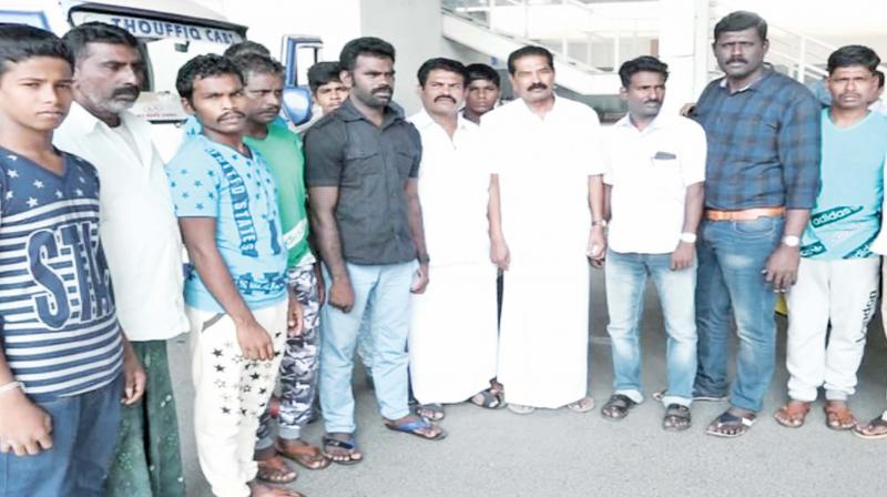 Two fisheries department officials (centre) along with released fishermen. (Image DC)