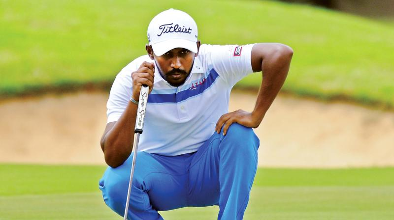 S Chikkarangappa lines up a putt during the third round at the KGA, on Saturday.(Photo: R. SAMUEL)