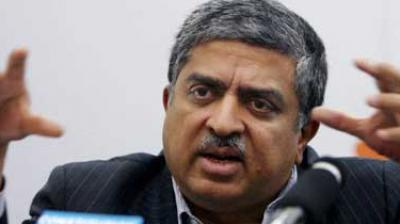 Nandan Nilekani is one of the seven founders of Infosys and called India's UID man as he spearheded the launch of Aadhaar project. He is all set to take back control of Rs 64,000 crore or $10 billion company at a time when rift between the founders and the management has come out in open. (Photo: PTI)