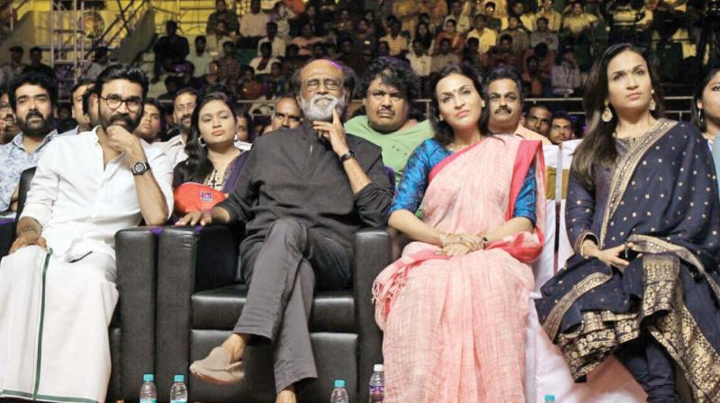 Dhanush, Rajinikanth and Aishwarya at the event.
