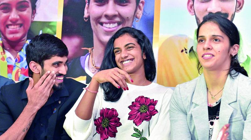 Shuttlers Srikanth Kidambi (from left), P.V. Sindhu and Saina Nehwal share a light moment at a felicitation ceremony in New Delhi on Thursday (Photo: AP)