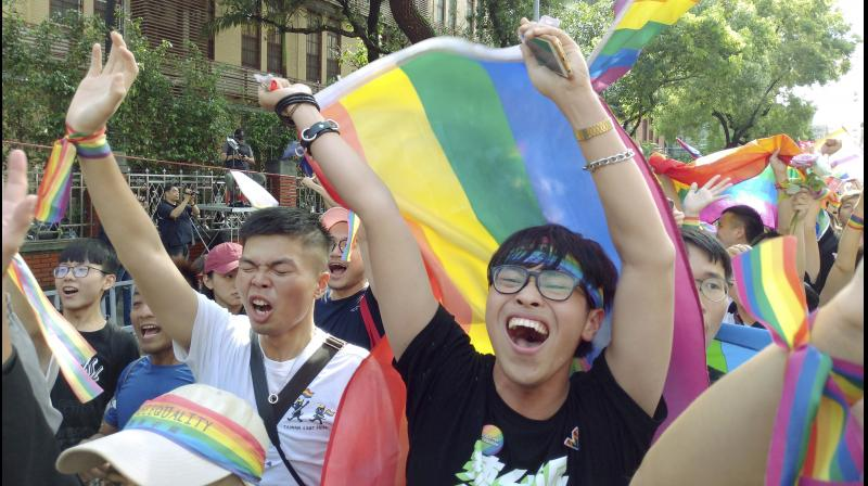 Some dozen couples were among the first to arrive at a government office in downtown Taipei to legally register their relationships as marriages. (Photo:AP)
