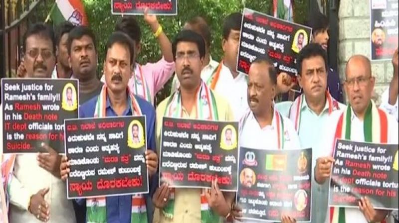 While one placard sought justice for the deceased and the other accused government of targeting the leaders to take the political revenge. (Photo: ANI)