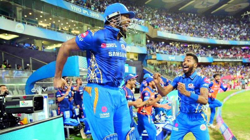Kieron Pollard (left) celebrates with teammate Hardik Pandya after Mumbai Indians beat Kings XI Punjab at the Wankhede Stadium in Mumbai on Wednesday.(Photo: BCCI)