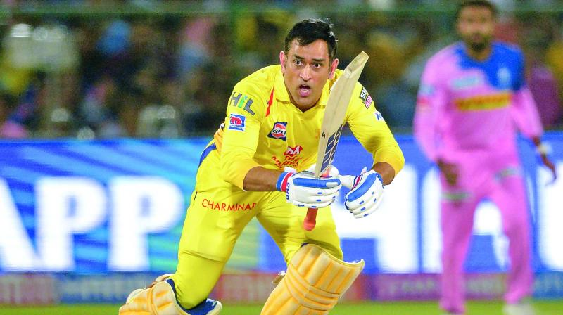 Chennai Super Kings captain Mahendra Singh Dhoni plays a shot on way to his half-century against Rajasthan Royals at the Sawai Mansingh Stadium in Jaipur on Thursday (Photo: AFP)