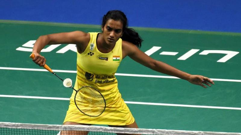 Ace Indian shuttler PV Sindhu on Friday came back from one game down to beat Japan's Nozomi Okuhara 20-22, 21-18, 21-18 in the quarterfinals of the All England Championships, thereby advancing to the semifinals. (Photo: AFP)
