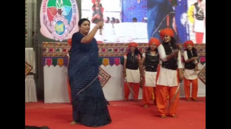 Irani, who was seen holding two swords on the stage, tried her best to match steps with the performers there. (Photo: ANI)