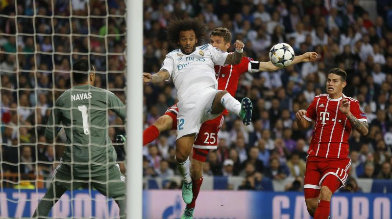 The Bundesliga champions also had a penalty appeal waved away when their Polish striker Robert Lewandowski went down under a challenge from Real captain Sergio Ramos. (Photo: AP)