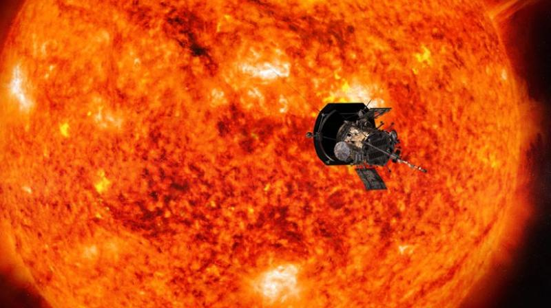 This illustration from NASA shows the Parker Solar Probe spacecraft approaching the sun. Launched in August 2018, the spacecraft will get a gravity assist on October 3, 2018, as it passes within 1,500 miles of Venus. (Steve Gribben/Johns Hopkins APL/NASA via AP)