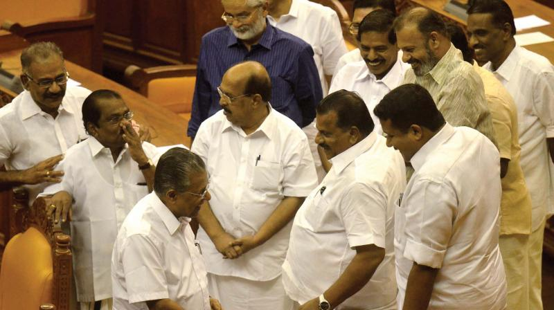 Chief Minister Pinarayi Vijayan with LDF MLAs and ministers before the presentation of the Solar Commission report in the Assembly on Thursday. (Photo: Peethambaran Payyeri)