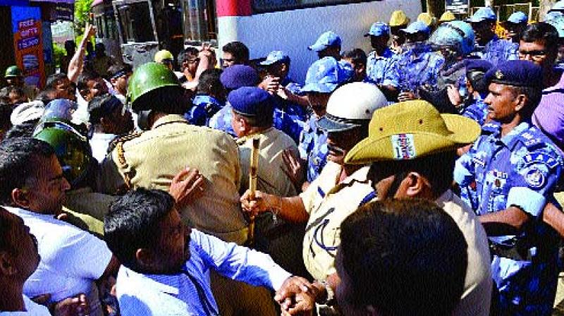 BJP activists court arrest in Madikeri on Friday (Photo: KPN)